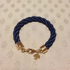 Kate spade rope bracelet Navy. Wore a few times. Some tiny not noticeable scratches on the gold. kate spade Jewelry Bracelets