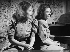 Twin sisters and pianists Mary and Geraldine Peppin appear on the BBC television show 'Designed For Women', UK, April Original publication: Picture Post - 4543 - Never Include A Man - pub. April 1948 (Photo by Kurt Hutton/Picture Post/Getty Images) Twin Photos, Couple Photos, Bbc, Twin Sisters, Romance Novels, Twins, The Originals, Mary, Women
