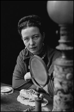 Elliott Erwitt, French writer Simone de Beauvoir at home, Paris, France, 1949.