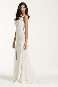$700 Prepare to dazzle your guests in this breathtaking crepe tank sheath bridal gown, featuring a plunging illusion neckline and front-slit skirt, guaranteed to be a showstopper!  Boatneck tank bodice with plunging illusion neckline, 3D floral and sequined lace appliques.  Deep V back and front slit skirt adds drama to this already impeccable gown.  Attached grosgrain ribbon at waist ties this look together.  Sweep train.  Sizes 0-14. Available in select stores and online in Ivory.  Back…
