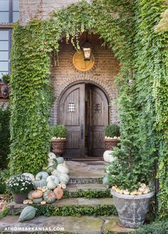Big The home's front door was designed to set the tone for the European-inspired interiors. A French, antique terra cotta fragment is framed into the brick exterior, which features weeping mortar for added texture and interest. At Home in Arkansas Seasonal Decor, Fall Decor, Beautiful Front Doors, Fall Images, Entry Foyer, Gardening, Belleza Natural, Autumn Home, Autumn Garden