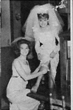 Kathy Lennon, maid of honor, places the lucky garter on her younger sister, Janet, for her wedding on May 7, 1966. Kathy married the next year on June 26, 1967.