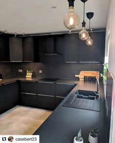 Image may contain: indoor Kitchen Room Design, Home Decor Kitchen, Interior Design Kitchen, Kitchen Furniture, Modern Kitchen Interiors, Contemporary Kitchen Design, Black Kitchens, Home Kitchens, Black Kitchen Cabinets