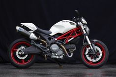 Ducati Monster 696 -Love the red frame against the white!