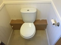 Cover up for pipes behind the toilet by woodpecker joinery services