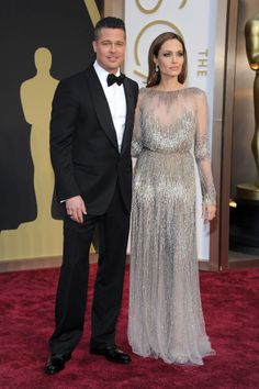 This power couple can wear no wrong. A classic black tux on Brad and a metallic silver gown on Angelina. #oscars2014