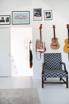 Sam & Anne's Cozy Modern Blend / guitars on walls with prints?