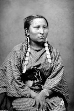 Unidentified Dakota Sioux woman. Photographed between 1870-80.