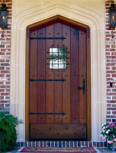 European style solid wood door with gothic arch and speakeasy.
