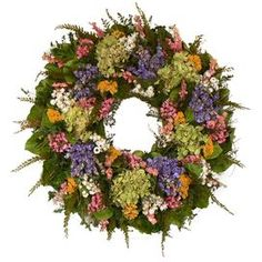 """Mixed preserved floral wreath with a natural twig base.   Product: Preserved floral wreathConstruction Material: Natural twig base and preserved materialsColor: Green, lavender, pink, white and yellowFeatures: Includes preserved cynthia Made in the USADimensions: 22"""" DiameterCleaning and Care: Avoid direct sunlight and humidity. Wipe gently clean with dry cloth."""