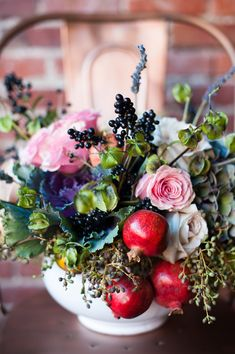 Gathered bouquet Centerpiece with flowers and berries and mini pomegranates. Would be beautiful for thanksgiving!