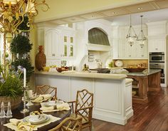The bright, cheerful kitchen has cream-colored glazed cabinetry and
