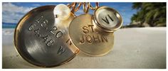 Yeah! Bamboo Studio on St. John has personalized charm necklaces in mixed metals, gold and silver, long chain.
