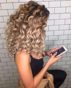curly blonde hair.