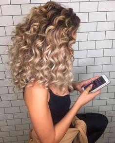 curly blonde hair. https://www.facebook.com/shorthaircutstyles/posts/1719699238320516