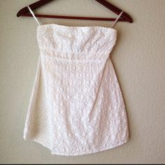 """White Boho Strapless Top Adorable soft white strapless top. Has boho/sun eyelet top layer with cream lining underneath. Baby doll style so it's loose under the bust, very figure flattering. Smocked back to ensure comfy fit. Also has option to add straps (I need to find them, I never used them ). Only worn a few times, perfect condition!   Measurements: 12.5"""" across the top (laying flat/stretchy), 19"""" long. Condition: GUC, like new.  Trades  Please ask any questions prior to purchasing. All…"""