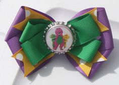Barney Purple Green and Yellow Hair Bow by bowsforme on Etsy, $5.99