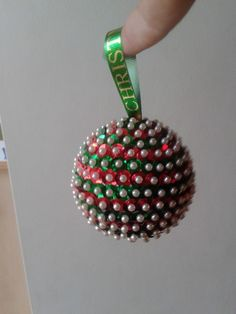 Christmas Bauble made from a polystyrene ball, sequins and bridal pins.