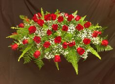 Red roses casket spray created by Pam w