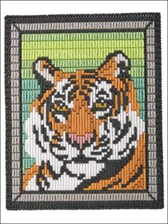 "Sharply contrasting colors provide surprising detail in this long-stitched re-creation of the majestic tiger. This e-pattern was originally published in Picture It in Long Stitch. Size: 8 5/8"" x 10 3/4"" (21.9cm x 27.3cm). Made with plastic canvas yarn and 7-count plastic canvas. Skill Level: Intermediate"