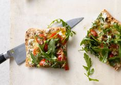 Arugula and eggplant pizza.  This is one of my all-time favorite vegetarian meals.  I use flatbread instead of lavash and it works perfectly.  I balked slightly at the arugula being tossed in lemon juice, but it is absolutely the key element to this dish.