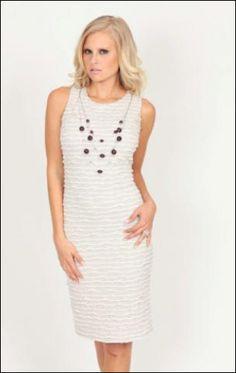 Cute little white Frank Lyman dress with detachable necklace.