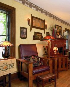 The long living room in a Midwest bungalow is filled with American Morris chairs as well as wicker and period lithographs. Photo: Jessie Walker Love that throw pillow! Craftsman Living Rooms, Craftsman Decor, Craftsman Furniture, Craftsman Interior, Craftsman Style Homes, Craftsman Houses, Craftsman Bungalows, Arts And Crafts Interiors, Arts And Crafts Furniture