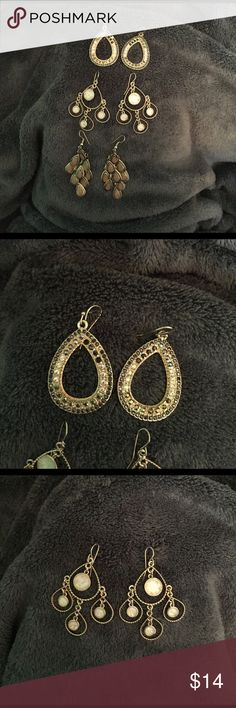 *SET OF 3* brownish/neutral Earrings Hardly ever worn, in great condition. First pair has got some brown/silver to it. Second pair has an iridescent glow to it. Third pair looks orangish, but is more of a light/neutral color brown. Jewelry Earrings