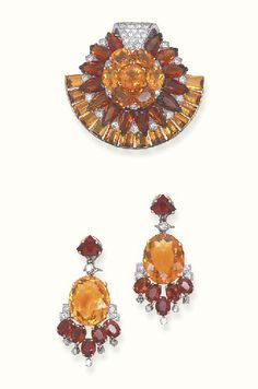 A SET OF CITRINE AND DIAMOND JEWELLERY, BY CARTIER   Comprising a clip brooch, designed as a sunflower set with vari-cut two-toned citrines, enhanced by circular-cut diamond detail to the rectangular-cut citrine crescent trim; and a pair of ear pendants en suite, mounted in 18k gold and platinum, circa 1950  Signed Cartier, London