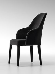 Audrey chair with pure and simple lines brings timeless style and charm. Beautiful silhouette and dark tones thanks to precious velvet. #Fendi #FendiCasa #Saloni Presented by Luxury Living