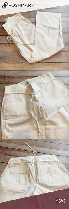 "NWOT ON White Wide Leg Trousers ☀️NWOT ON Bright White Ladies Wide Leg Summer Weight Trousers ☀️Button fly and top closure with string belt made of same material as pants ☀️Size 6 | 96% Cotton, 4% Spandex ☀️Inseam 30.5"" ☀️Waist 15.5"" ☀️Bought these to wear to work and never had them hemmed to wear with flats...and was always afraid I would get them dirty on the train.  ☀️☀️☀️Life is short. Wear the white pants and look fabulous. You can always bleach them. Old Navy Pants Trousers"
