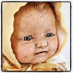 antique abandoned baby doll