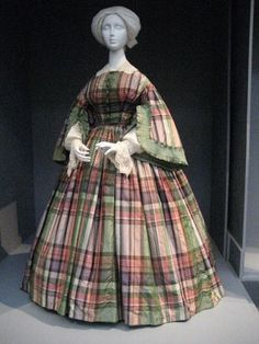 1855 Plaid Dress - typical use of bold pattern and bright colors