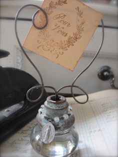 Inspiration or picture holders with wire, vintage rhinestones, tags, charms, beads and vintage door knobs