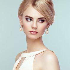 Portrait of beautiful sensual woman with elegant hairstyle - Portrait of beautiful sensual woman with elegant hairstyle.  Perfect makeup. Blonde girl. Fashion photo. Jewelry and dress