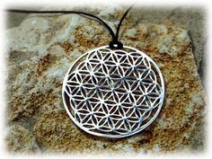 Flower of life pendant. The pattern scales so brilliantly from huge to intricately small like this, would make a cool tattoo!