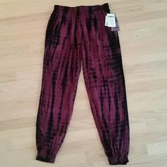 NWT Maroon and Black Tie-Dye Joggers These never worn, NWT joggers are light weight, and very versatile. Fitted at the bottom, they drape down beautiful for ultimate comfort. Equipped with an elastic waistband for extra stretch and pockets, these joggers are perfect for the spring or summer! Rewash Pants Track Pants & Joggers