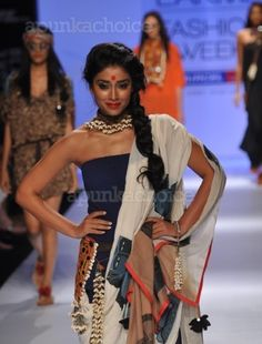 Shriya Saran sets the ramp ablaze at Lakme Fashion Week Summer/Resort 2013    Fashion designer Asmita Marwa used a mix of mirror work, shells and antique prints to bring forth a gypsy look in her creations, showcased Friday at the Lakme Fashion Week (LFW) summer-resort 2013 here. ActressShriya Saranturned up as the showstopper.