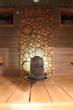 Sauna. Effect wall made from pine plates. Kiwi stove from Harvia.