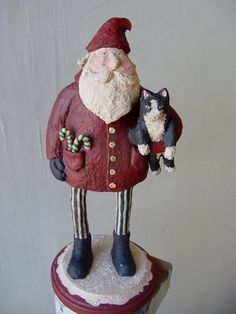 Santa with cat -some of the most unique hand made art pieces I have ever seen. I have acquired several snowmen and santas for myself and given as gifts for Christmas -Agnes Unlimited on Etsy !!
