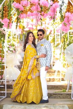 Looking for A bride in yellow lehenga poses with her husband-to-be on her mehendi day? Browse of latest bridal photos, lehenga & jewelry designs, decor ideas, etc. on WedMeGood Gallery. Engagement Dress For Groom, Couple Wedding Dress, Wedding Dresses Men Indian, Engagement Dresses, Indian Engagement Outfit, Wedding Outfits For Groom, Groom Wedding Dress, Indian Gowns, Indian Groom Wear