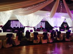 Your evening reception in the Ballroom can be made to look spectacular with various ceiling drapes and light up curtains  Decorated by Wedding Creations & Creative