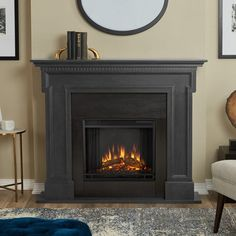 Real Flame Thayer Electric Fireplace Gray - inset details and traditional style complete the look of this exquisite mantel. The Vivid Flame Electric Firebox easily plugs into any standard outlet with features including remote control, p Electric Fireplace With Mantel, Electric Fireplaces, Indoor Fireplaces, Brick Fireplaces, Painted Fireplaces, Modern Fireplaces, Custom Neon, Portable Fireplace, Wooden Mantel