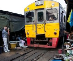 Three unique markets to visit in Thailand, including the Risky Market, which has a train line running through it.