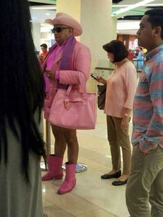 The bravest pink cowboy there ever was. What would you do if you saw him in the airport. What if you had to sit by him?