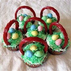 """Easter Surprise Cupcakes   """"These were fun to make with the kids. We decorated the cupcakes to look like """"baskets"""" using licorice sticks for handles, green coconut for grass, and mini peanut butter eggs!"""" -Chocolate Moose"""