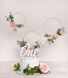 PINK FLORAL RINGS First birthday cake smash photo shoot ideas and setups
