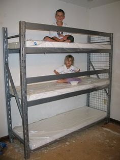 Nearly 4 years later, my kids STILL sleep on this shelf bunk bed. :) My dd has her own room now, but the 3rd son now sleeps on the bottom. I cover the foam with thick contractor trash bags, then for sheets, I took some twin size flat sheets and sewed them up on the side and one end to make it like a pillow case. They fit perfectly and are so easy to take off and wash. I really love this DIY space saver! Best triple bunk bed ever! (Ignore the floor, we were doing a lot of remodeling!)