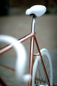 Copper/ rose gold and white details bike.  So cute!
