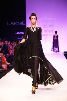 Black Silk Mul Raised Hem Kurta worn with Churidaar. Shop The Look at http://www.payalsinghal.com/off-the-runway/bahar-suit